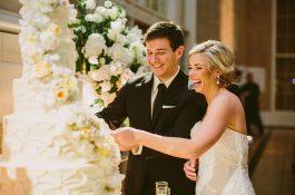 Happy couple cut wedding cake
