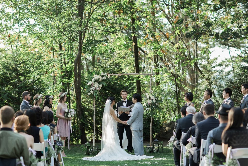 Ceremony with asymmetrical flower arch